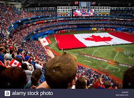 the teams u0027 national anthems are sung as a canadian flag is rolled
