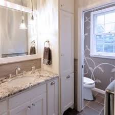 Bathroom Vanity With Linen Tower White And Gray Master Bathroom Features Walls Painted Soft Creamy