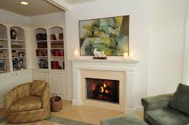 interior white fireplace with cream surround connected by white