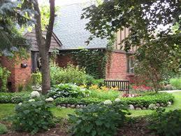 cottage style backyards english cottage landscape design with lush green gardens