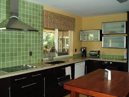 wonderful black finished kitchen cabinet with green tile wall