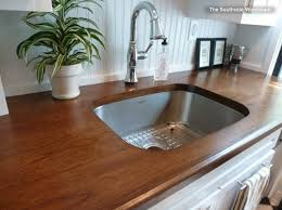kitchen with white cabinets and wood countertops the best backsplashes to pair with wood counters bergdahl