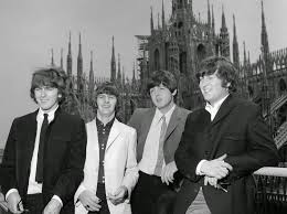 the beatles on their hotel terrace in milan italy with il duomo
