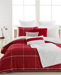 bedroom red plaid flannel sheets with white throw pillows and