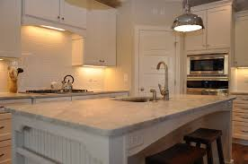 granite countertop blue kitchen with oak cabinets backsplash
