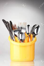 kitchen cutlery knives kitchen cutlery knives forks and spoons in yellow stand on