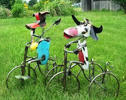 scrap metal cow on trike with potholder basket