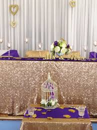 wedding backdrop on a budget sequin tablecloth sequins gold glitter peonies purple small