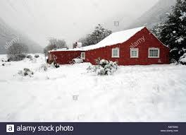 Snow At Home by A Red Farm Building In The Snow At Arthurs Pass Canterbury New