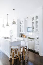 Kitchen Subway Tile Backsplash by White Kitchen With White Beveled Subway Tile Backsplash