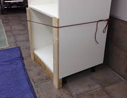 the fix it blog sorting things out garage organization using jig ties around the cabinet allows you to lift the cabinet vertical with one person without bearing on the plastic feet