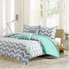 Blue And White Comforter Brown Wooden Bed With White Bedding Blue Grey Pillows And Blanket