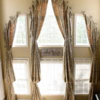 furniture beige grommet top curtain with brown wooden rods