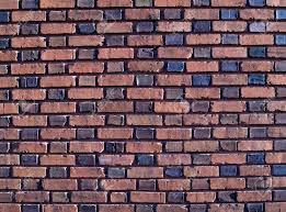 multi colored and duo sized old exterior brick wall stock photo