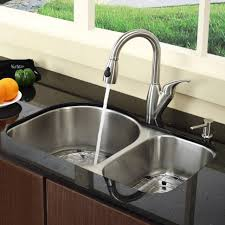 kitchen white sink with stainless steel faucet bowl