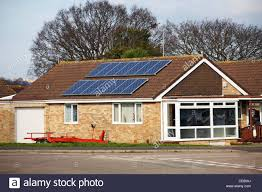 solar panels on roof of bungalow in poole stock photo royalty