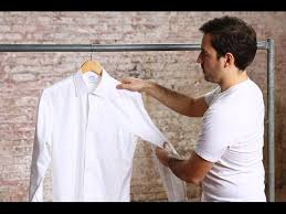 Learn the military tuck for keeping a dress shirt neat with this video