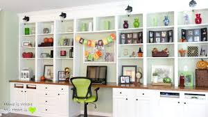 decorated wall to wall built in shelves and desk home is where