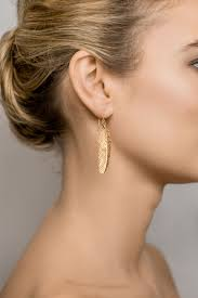 gold feather earrings feather earrings vimanas jewellery gold or silver