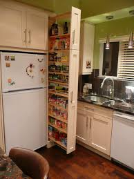 pull out tall kitchen cabinets the narrow cabinet beside the fridge pulls out to reveal a spice