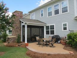 screened porch with wood burning fireplace and paver patio