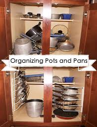 how to organize pots and pans in a cupboard organizing your pots and pans jamonkey