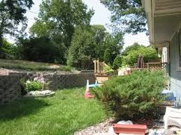 Backyard Ideas For Sloping Yards Ideas For Sloping Backyard And Retaining Wall