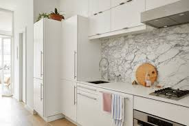 how to fix kitchen base cabinets to wall the best ikea hacks on the architectural digest