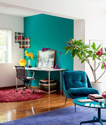 vibrant turquoise wall to highlight and separate the home office