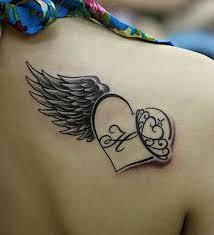 black simple heart tattoo tattoomagz