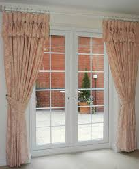 interior french door window with white tab top curtain hanging on