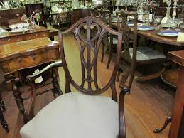 pair of antique english mahogany hand carved shieldback arm chairs