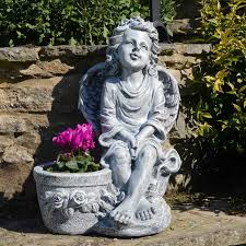 cherub with planter garden ornament
