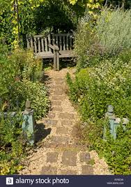 English Cottage Gardens Photos - small english cottage garden with paved and gravel path borders