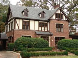 decorating simple tudor style architecture idea with brown brick