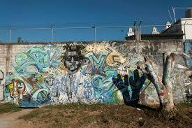 wall art viviane moos documentary photographer on a park wall the signature tag of artist senor on his portrait of michael jackson