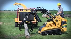 s725tx with log grapple mini skid steer vermeer tree care