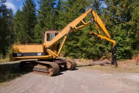 caterpillar 235 log loader excavator