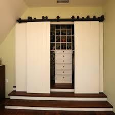 interior barn doors living room rustic with built in bookshelves beams