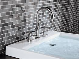 long bathroom sink with two faucets how to pick bathroom faucets hgtv