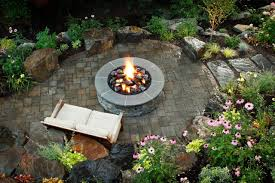 garden with butterfly chairs and fire pit warm and useful