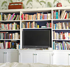 classic rustic white wooden bookshelves with book colection for