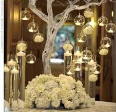 all white tree centerpiece with tea lights surrounded by fl