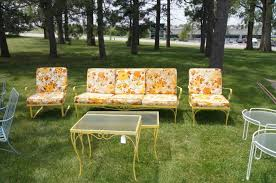 simple cute vintage metal patio chairs and old fashioned metal bench with a lots of outdoor