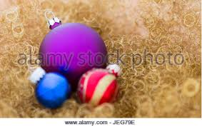 blue silver and purple christmas tree baubles in a box stock