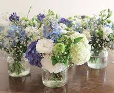 wedding flowers jam jars beautiful jam jar of sweet peas verbena and delphiniums etc