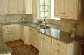 white kitchen cabinets with green countertops m interiors how to make forest green work in your