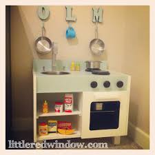 an ikea hack play kitchen for o little red window