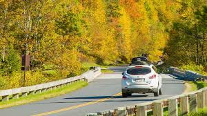 tilting up from traffic on the blue ridge parkway past fall
