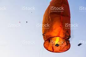 lantern kites burnt damaged sky lantern with kites in background stock photo